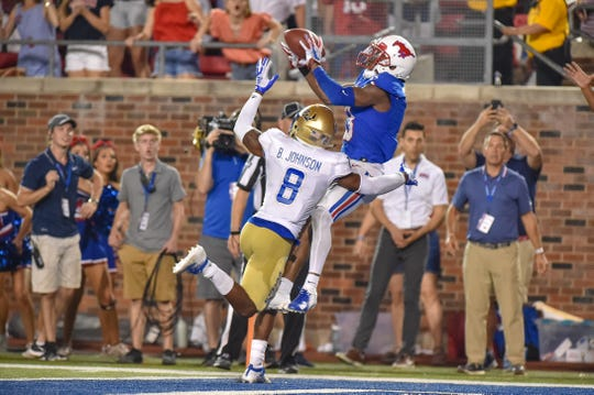 Oct 5, 2019; Dallas, TX, USA; SMU wide receiver James Proche (3) makes the winning touchdown catch during the third overtime against Tulsa at Gerald J. Ford Stadium. Mandatory Credit: Timothy Flores-USA TODAY Sports