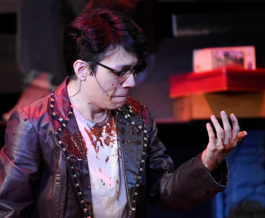 """Ricky Martinez examines blood on his hands during the """"Evil Dead the Musical"""" rehearsal, Wednesday, Oct. 16, 2019, at Harbor Playhouse. Martinez plays Scott."""