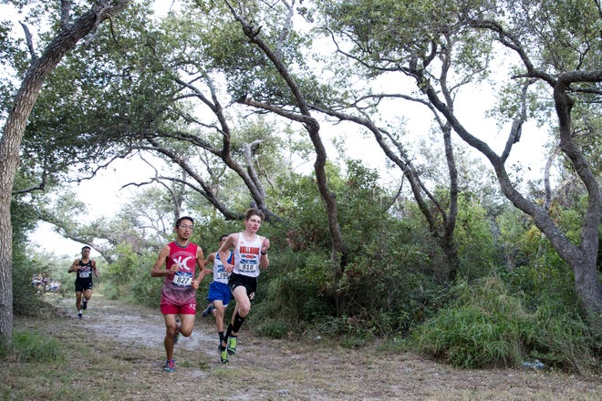 Varsity boys compete at the District 31-4A cross country meet at Live Oak Park in Ingleside on Thursday, October 17, 2019.