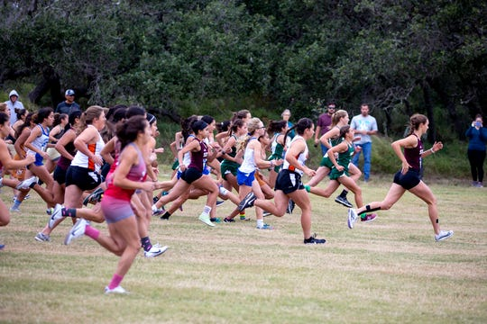 Varsity girls compete at the District 31-4A cross country meet at Live Oak Park in Ingleside on Thursday, October 17, 2019.