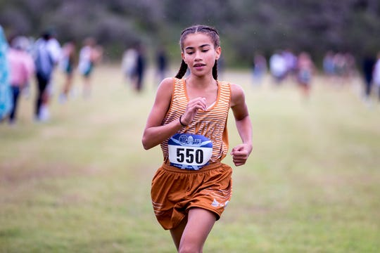 Jada Johnson, with Beeville, places first in the varsity girls District 31-4A cross country meet at Live Oak Park in Ingleside on Thursday, October 17, 2019.