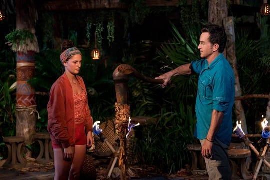 'Survivor' host Jeff Probst extinguishes Chelsea Walker's torch at Tribal Council on the fourth episode of 'Survivor: Island of the Idols.'