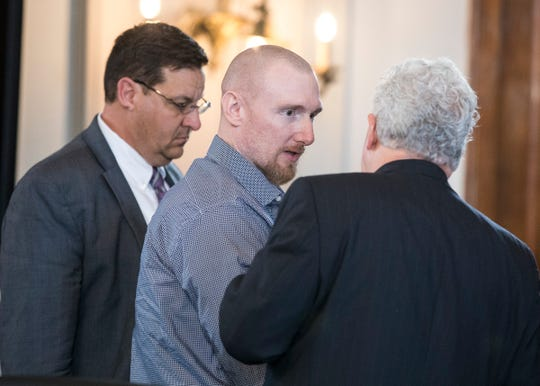 "Jesse Hanes talks with his lawyers Kirk McVay and John Randall Cornley as he gets up to leave after pleading guilty to charges of aggravated murder in connection with his part in the 2016 shooting death of Theodore ""Ted"" Timmons in a plea deal where he will avoid the death penalty but will have to serve life in prison without possibility of parole in front of Judge Mike Ater in the Ross County Common Pleas Court on Oct. 17, 2019."
