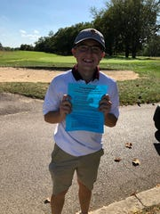 Turpin golfer Max Meyer holding his notice that he advanced to the Division I Southwest District Tournament