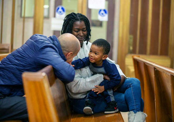 Anedrea McKinstry of Avondale, with her son Michai Anderson, 2, talks with Cincinnati councilman Greg Landsman before she faces a magistrate during an eviction hearing Thursday, October 17, 2019, at the Hamilton County Courthouse. Landsman is working to keep people in their homes with a series of eviction prevention laws he'll introduce this month.
