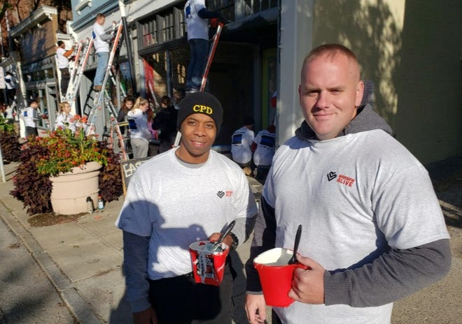 New Cincinnati police officers took the streets in East Price Hill Thursday to spruce up the neighborhood with fresh paint and plants.