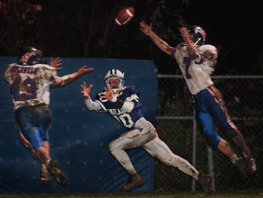 November 21, 1997: Cross-town rivals Covington Catholic and Highlands squared off in their second meeting of the year. Here, Highlands QB Jared Lorenzen (not seen) led Josh Hasson (10) perfectly on this diving TD pass in the end zone, splitting the defense of CovCath's Nick Lanham (49) and Tom Beechem (7).