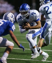 October 14, 2016: Covington Catholic quarterback AJ Mayer carries the ball down to the one-foot line during the first quarter of their game at Highlands.