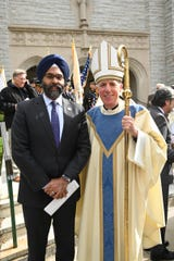 New Jersey Attorney General Gurbir Grewal and Bishop James F. Checchio pose for a photo after greeting one another following the Diocese of Metuchen's 2019 Blue Mass, held Oct. 17 at the Cathedral of St. Francis of Assisi, Metuchen.