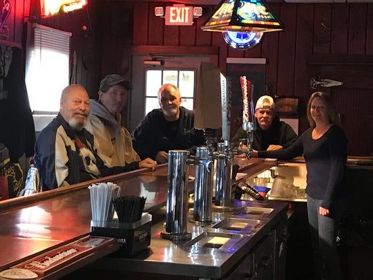 Barbara Yesaitis with customers at Parkside Tavern in Jamesburg