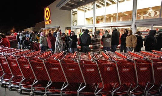 Shopping carts create a chute for waiting Black Friday shoppers outside the Target store at Merle Hay Mall.