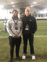 Iowa recruits and high school teammates Isaiah Bruce (left) and Gennings Dunker pose together during an unofficial visit to Iowa.