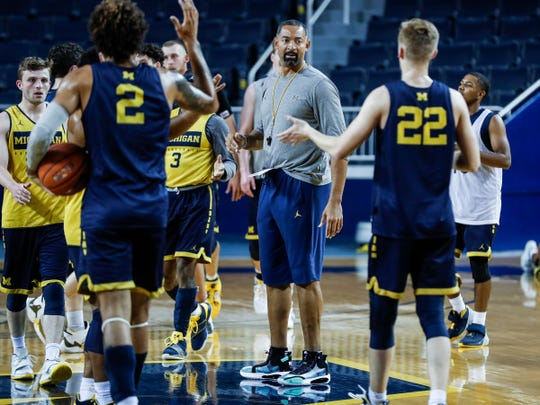 Michigan head coach Juwan Howard talks to players at practice during media day at Crisler Center in Ann Arbor, Thursday, Oct. 17, 2019.