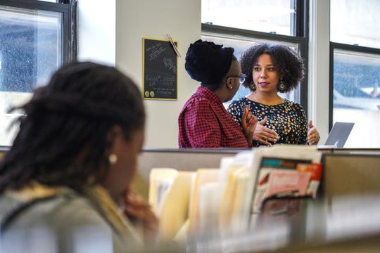 Detroit Justice Center Executive Director Amanda Alexander (right) talks with Development Manager Tiffany Mott at the Detroit Justice Center office in downtown Detroit, Tuesday, Oct. 15, 2019.