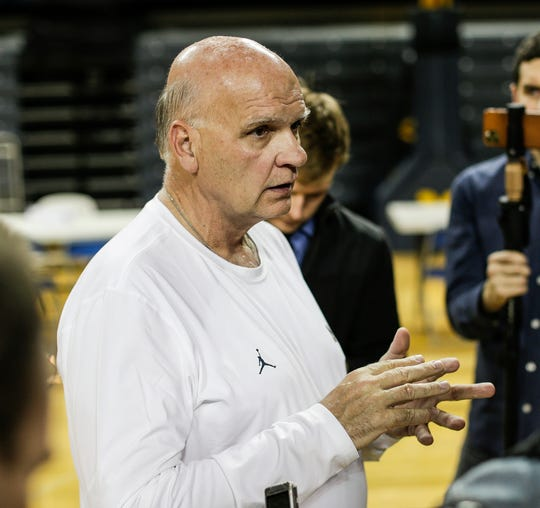Michigan associate head coach Phil Martelli answers a question during media day at Crisler Center in Ann Arbor, Thursday, Oct. 17, 2019.
