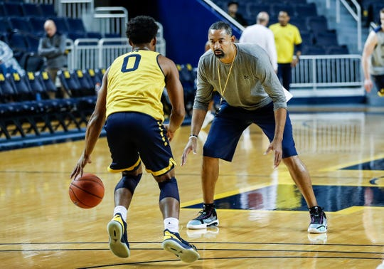 Michigan head coach Juwan Howard practices with guard David DeJulius (0) during media day at Crisler Center in Ann Arbor, Thursday, Oct. 17, 2019.