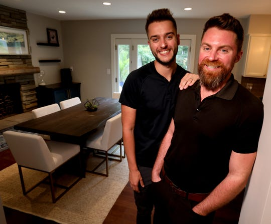 Darrin Driesenga, 28, and partner Chris Roberts, 34, inside the dining area of their Royal Oak home on Oct. 1, 2019.