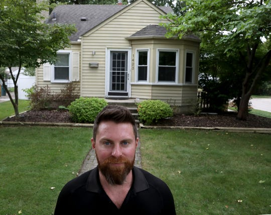 Chris Roberts, 34, in front of his old house on Oct. 1, 2019. Roberts bought this home in 2012 and sold recently it after doing a quick all-cash deal with a real estate agent who bought this home.  He thinks he could have received $20,000 more had he tried to sell this house through a regular listing but the selling approach the agent had Roberts felt it reduced the hassle factor for him.