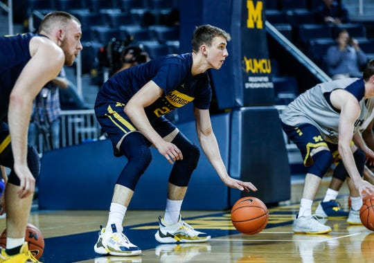 Michigan guard Franz Wagner (21) practice during media day at Crisler Center in Ann Arbor, Thursday, Oct. 17, 2019.