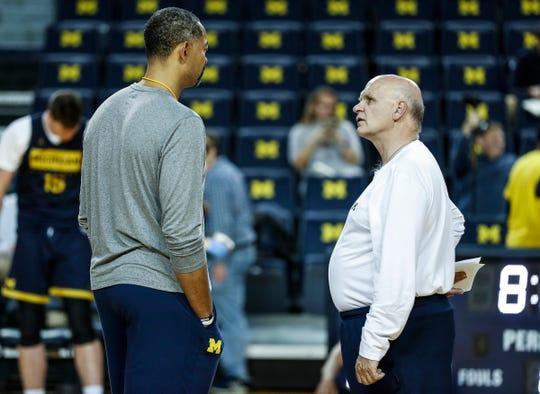 Michigan head coach Juwan Howard talks to associate head coach Phil Martelli at practice during media day at Crisler Center in Ann Arbor, Thursday, Oct. 17, 2019.