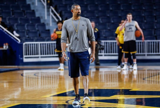 Michigan head coach Juwan Howard watches practice during media day at Crisler Center in Ann Arbor, Thursday, Oct. 17, 2019.