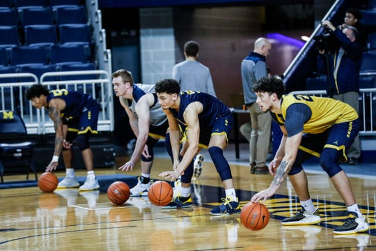 Michigan players, including guard Adrien Nunez (5) and forward Brandon Johns Jr. (23) practice during media day at Crisler Center in Ann Arbor, Thursday, Oct. 17, 2019.