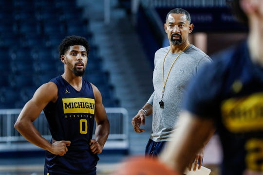 Michigan guard David DeJulius (0) talks to  head coach Juwan Howard at practice during media day at Crisler Center in Ann Arbor, Thursday, Oct. 17, 2019.
