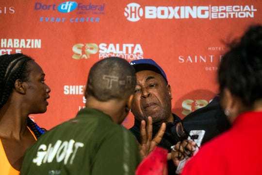 Boxer Ivana Habazin's trainer Bashir Ali, right, trash talks with members of Claressa Shields' entourage during a weigh-in Friday, Oct. 4, 2019, in Flint.