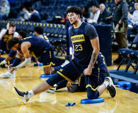 Michigan forward Brandon Johns Jr. (23) warms up for practice during media day at Crisler Center in Ann Arbor, Thursday, Oct. 17, 2019.
