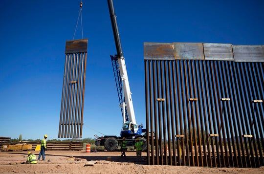 A piece of the 30-foot tall bollard fence is lifted and set into place as construction continues on replacing the old U.S./Mexico border fence two miles east of the Lukeville, Arizona port of entry on October 8, 2019.