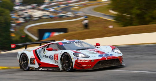 The Ford GT piloted by Scott Dixon, Ryan Briscoe, and Richard Westbrook at speed at Road Atlanta.