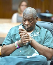 Charles Lewis wipes his eyes as Wayne County Circuit Court Judge Qiana Lillard orders that his life sentence be dropped and he be resentenced to 37 to 60 years in prison, making the juvenile lifer immediately eligible for parole.