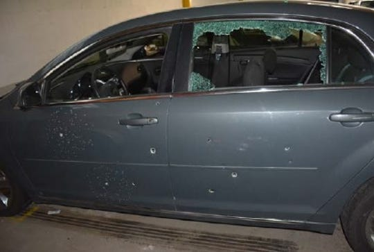 The two injured victims were shot inside this car, which was riddled with bullets.