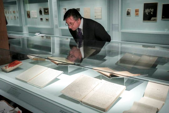 Declan Kiely, director of special collections and exhibitions at the New York Public Library, review manuscripts during the installation of the library's J.D. Salinger exhibit, Wednesday, Oct. 16, 2019, in New York.