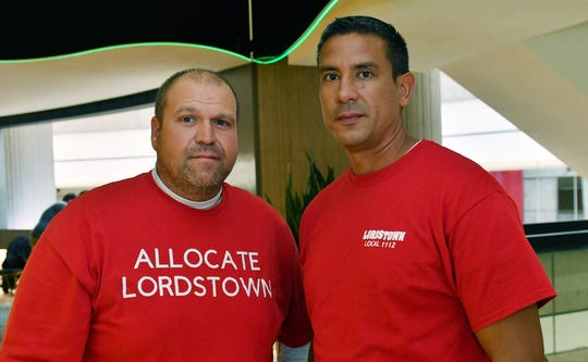 From left, Scott Brubaker and Hector Colon, both from Local #1112 in Lordstown, Ohio, were among some 40 workers from GM's idled Lordstown plant who encouraged local UAW leaders to vote no on the tentative agreement with GM.