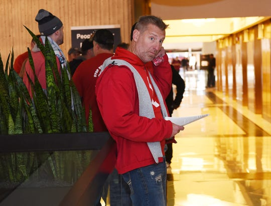 Matt Dzurinda of Local 1112  in Lordstown, Ohio, reads the highlights of the proposed new contract from GM Thursday in the Renaissance Center, where local union presidents and chairmen were holding a UAW GM national council meeting.