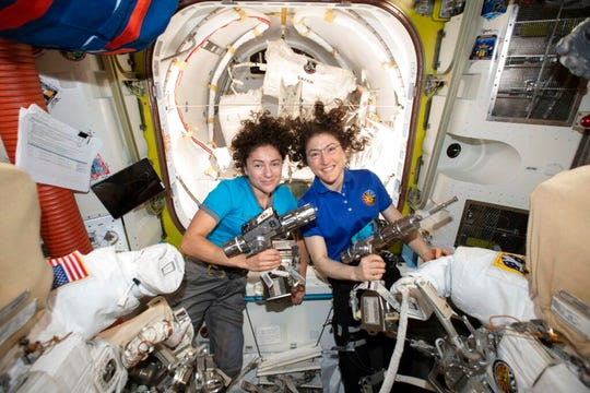 U.S. astronauts Jessica Meir, left, and Christina Koch in the International Space Station.
