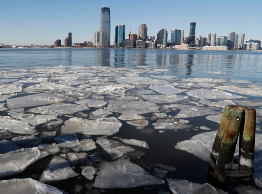 In this Jan. 7, 2018 file photo, ice floats in the Hudson River in Lower Manhattan with Jersey City, N.J., visible across the river.