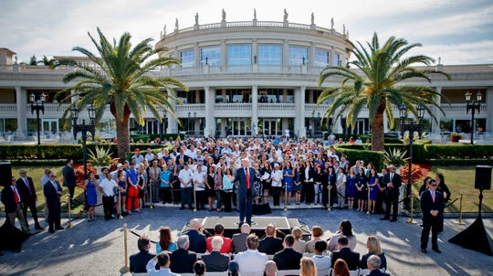This file photo from Tuesday, Oct. 25, 2016 shows then Republican presidential candidate Donald Trump speaking at a campaign event with employees at Trump National Doral in Miami.