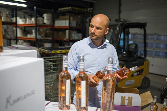 Sebastien Latz, director general of the French wine producer MDCV, inspects bottles of ros' in a wine production facility in the Chateau des Bertrands vineyard in Le Cannet-des-Maures, in the Provence region, Thursday Oct. 10, 2019.