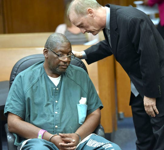 Juvenile lifer Charles Lewis listens to defense attorney Sanford Schulman during his hearing Thursday.
