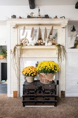A mantle over the fireplace is home to several repurposed pieces.