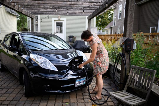 Jenn Morrow plugged in her Nissan Leaf electric vehicle, which is charged with solar power generated on site.
