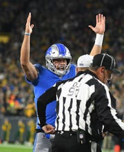 Lions quarterback Matthew Stafford signals for the touchdown, which have been few and far between in the red zone this season.