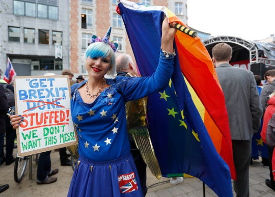 Madeleina Kay, political activist from Sheffield, England, participates in an anti-Brexit demonstration outside of an EU summit in Brussels, Thursday, Oct. 17, 2019.