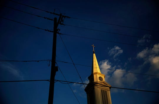 The sun sets on a Baptist church in Georgia. According to new data released by the Pew Research Center, the portion of Americans with no religious affiliation is rising significantly, in tandem with a sharp drop in the percentage that identifies as Christian.
