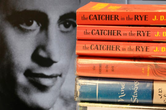 """In this Jan. 28, 2010, file photo, copies of J.D. Salinger's classic novel """"The Catcher in the Rye"""" as well as his volume of short stories called """"Nine Stories"""" are seen at the Orange Public Library in Orange, Ohio. An upcoming exhibit at the New York Public Library will offer a look into the very private life of Salinger."""