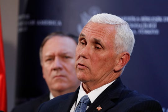 Vice President Mike Pence and Secretary of State Mike Pompeo hold a news conference at the Ambassador's residence after meeting with Turkish President Recep Tayyip Erdogan at the Presidential Palace, Thursday, Oct. 17, 2019, in Ankara, Turkey.