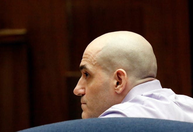 FILE - In this Aug. 15, 2019 file photo Michael Gargiulo listens as his guilty verdicts on all counts are read in Los Angeles Superior Court.