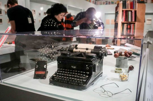 A typewriter, tobacco pipes, and eye glasses are part of a J.D. Salinger exhibit being installed at the New York Public Library, Wednesday, Oct. 16, 2019.
